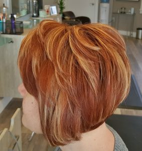 Red hair color with dimension done at our hair salon in Westborough, MA